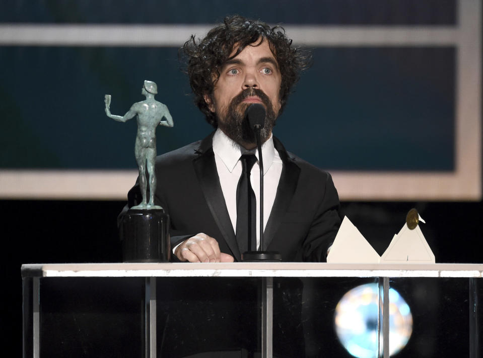 """FILE - Peter Dinklage accepts the award for outstanding performance by a male actor in a drama series for """"Game of Thrones"""" at the 26th annual Screen Actors Guild Awards on Jan. 19, 2020, in Los Angeles. (AP Photo/Chris Pizzello, File)"""