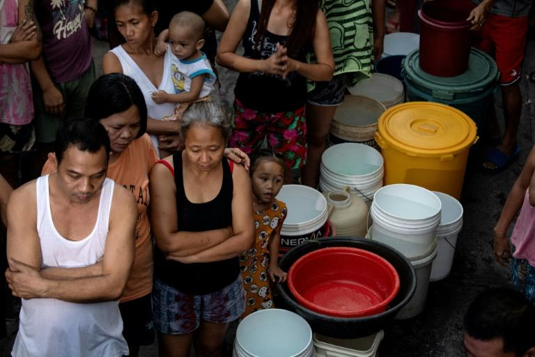 Residents of Manila, queue to recieve water distributed as the Philippine capital endures a prolonged drought