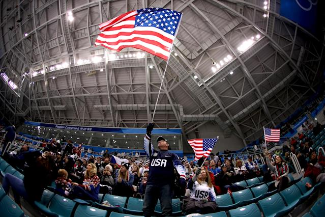 <p>A fan of team United States waves an American flag during the game against team Czech Republic during the Men's Play-offs Quarterfinals on day 12 of the PyeongChang 2018 Winter Olympic Games, February 21, 2018.<br>(Photo by Ronald Martinez/Getty Images) </p>