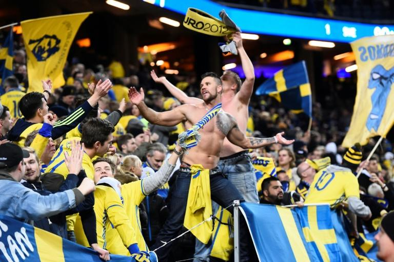 Swedish fans cheer after their team's victory in their FIFA World Cup 2018 qualification football match against Italy in Solna, Sweden on November 10, 2017