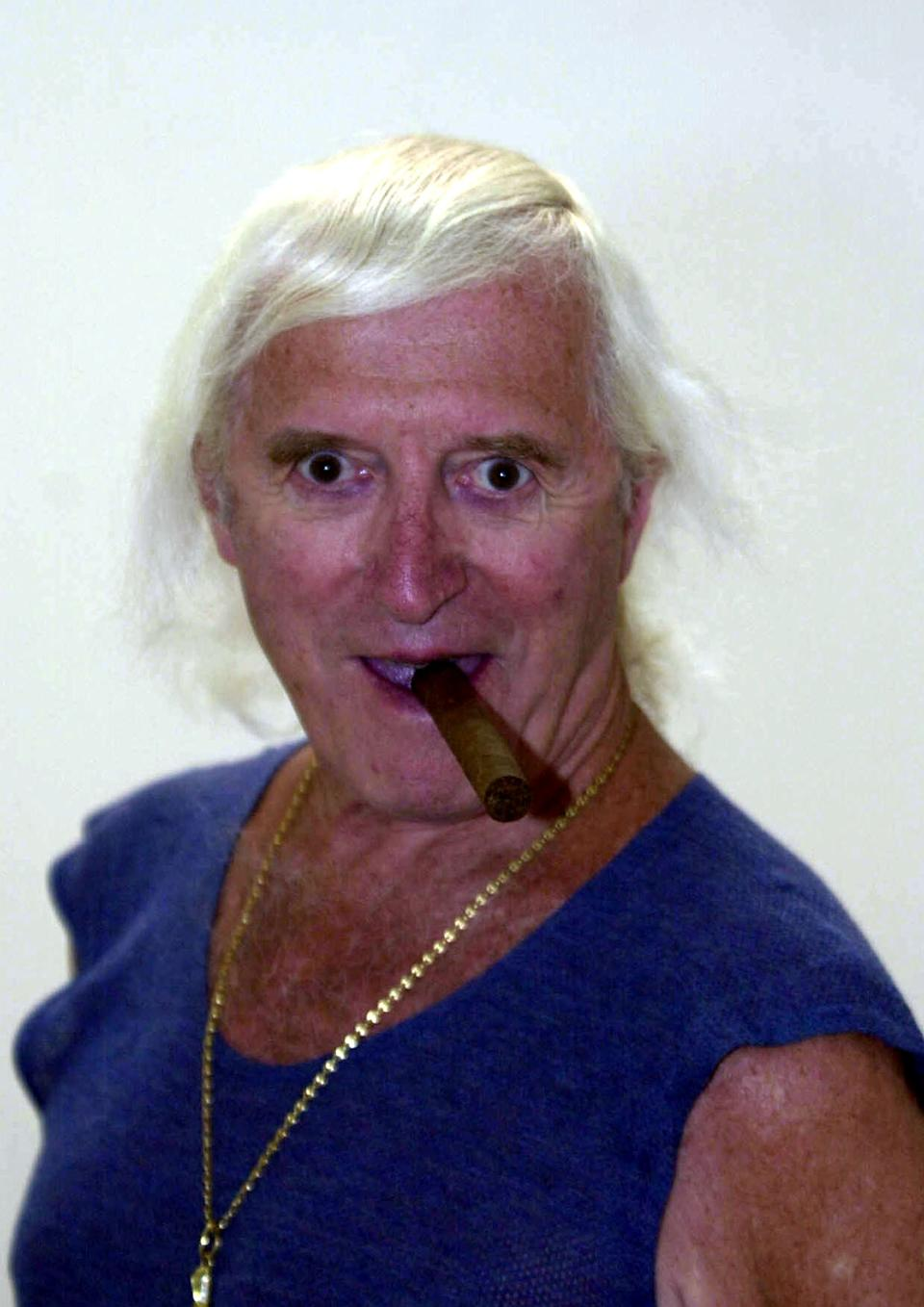 Sir Jimmy Savile launches the new exhibition Intelligence: New British Art 2000 at the Tate Britain, London.