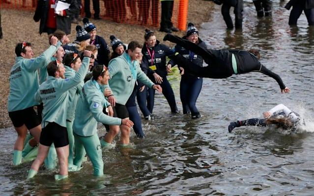 <span>Cambridge celebrate last year's win by throwing men's and women's coxes into the Thames</span> <span>Credit: Reuters </span>