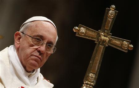 Pope Francis looks on as he celebrates a mass in Saint Peter's Basilica at the Vatican