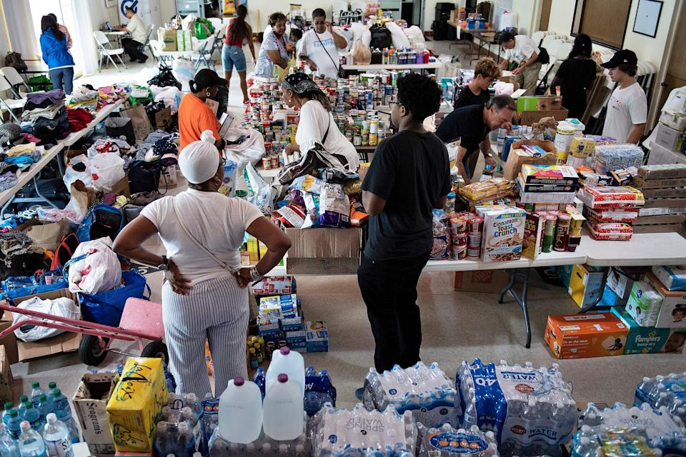 People gather donations for Hurricane Dorian relief at Christ Episcopal Church in Miami, Florida.