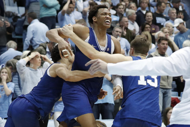 Duke forward Wendell Moore Jr., center, celebrates with guard Jordan Goldwire and forward Joey Baker (13) following Moore's game-winning shot in overtime against North Carolina in Chapel Hill, N.C., on Saturday, Feb. 8, 2020. (AP/Gerry Broome)