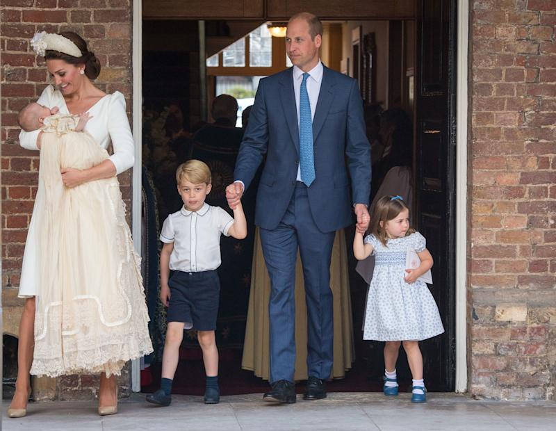Britain's Princess Charlotte of Cambridge and Britain's Prince George of Cambridge hold hands with their father, Britain's Prince William, Duke of Cambridge, as Britain's Prince Louis of Cambridge is carried by his mother, Britain's Catherine, Duchess of Cambridge after his christening service at the Chapel Royal, St James's Palace, London on July 9, 2018. (Photo by Dominic Lipinski / POOL / AFP) (Photo credit should read DOMINIC LIPINSKI/AFP via Getty Images)