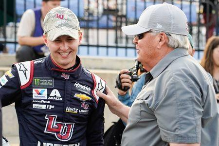 May 23, 2019; Concord, NC, USA; Monster Energy NASCAR Cup Series driver William Byron (24) celebrates with team owner Rick Hendrick for winning the pole during qualifying for the Coca-Cola 600 at Charlotte Motor Speedway. Mandatory Credit: Jim Dedmon-USA TODAY Sports