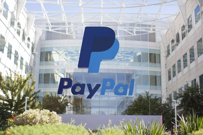 Building with PayPal logo on glass in atrium.