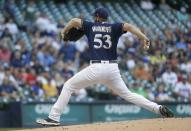 Milwaukee Brewers starting pitcher Brandon Woodruff throws during the first inning of a baseball game against the Atlanta Braves Tuesday, July 16, 2019, in Milwaukee. (AP Photo/Morry Gash)