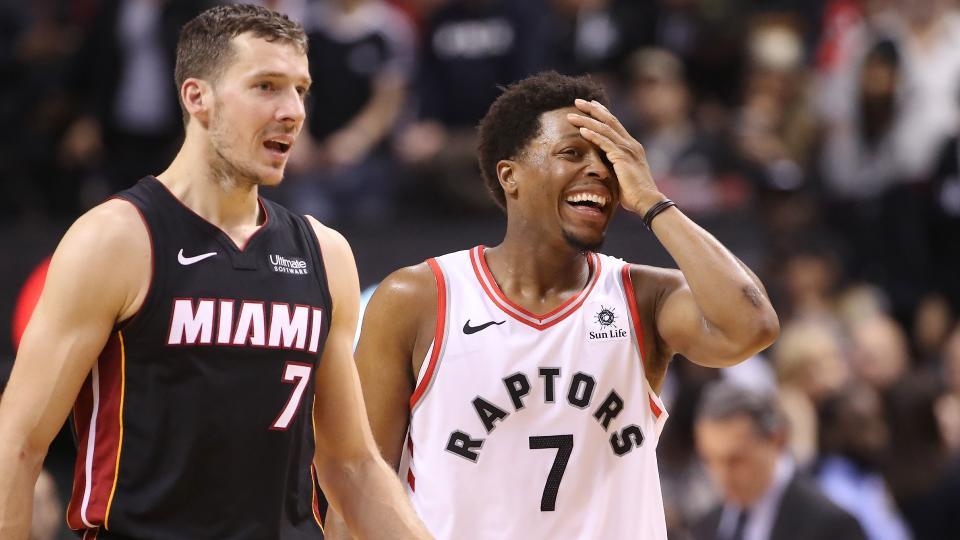 Kyle Lowry and Goran Dragic have swapped jerseys -- though Dragic won't keep the same number. (Photo by Tom Szczerbowski/Getty Images)