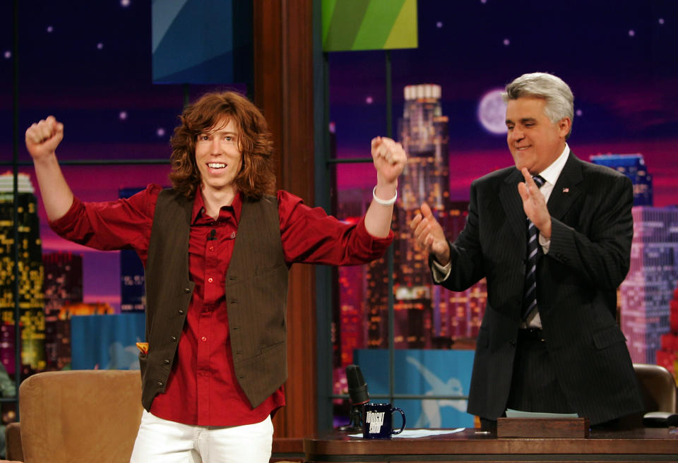 """<p>Snowboarder Shaun White, also known and """"The Flying Tomato,"""" who wan a gold medal in the Men's Halfpipe Snowboard competition at the Turin 2006 Winter Olympic Games acknowledges the audience as Tonight Show host Jay Leno looks on, Thursday, Feb. 16, 2006, in Burbank Calif. (AP Photo/Mark J. Terrill) </p>"""