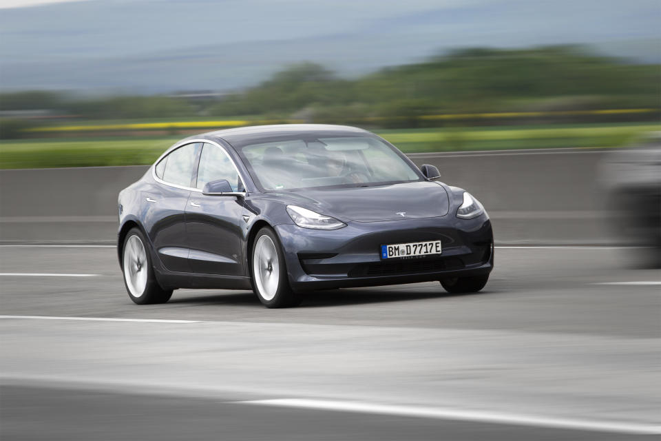 Diedenbergen, Germany - May 12, 2021: Tesla Model 3 on a highway nearby Wiesbaden in Germany. The Tesla Model 3 is an electric four-door fastback mid-size sedan developed by Tesla. Tesla, Inc. is an electric vehicle and clean energy company based in California.