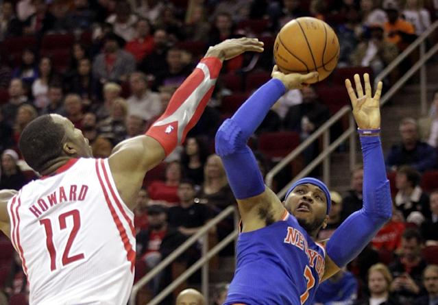New York Knicks forward Carmelo Anthony (7) shoots over Houston Rockets center Dwight Howard (7) during the second period of an NBA basketball game, Friday, Jan. 3, 2014, in Houston. (AP Photo/Patric Schneider)
