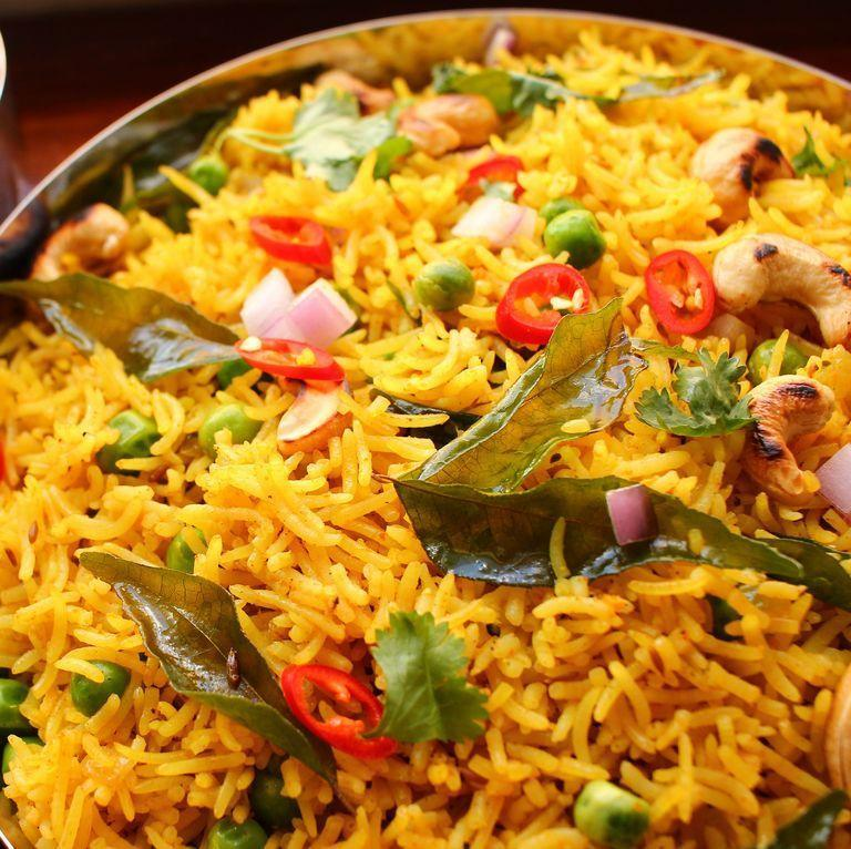 """<p>This version of curry rice is a sort of pilaf: rice is toasted in aromatic butter before being steamed to perfection. Perfectly spiced, it makes for a solid side dish, or a filling main.</p><p>Get the <a href=""""https://www.delish.com/uk/cooking/recipes/a33796271/curry-rice-recipe/"""" rel=""""nofollow noopener"""" target=""""_blank"""" data-ylk=""""slk:Curried Rice"""" class=""""link rapid-noclick-resp"""">Curried Rice</a> recipe.</p>"""