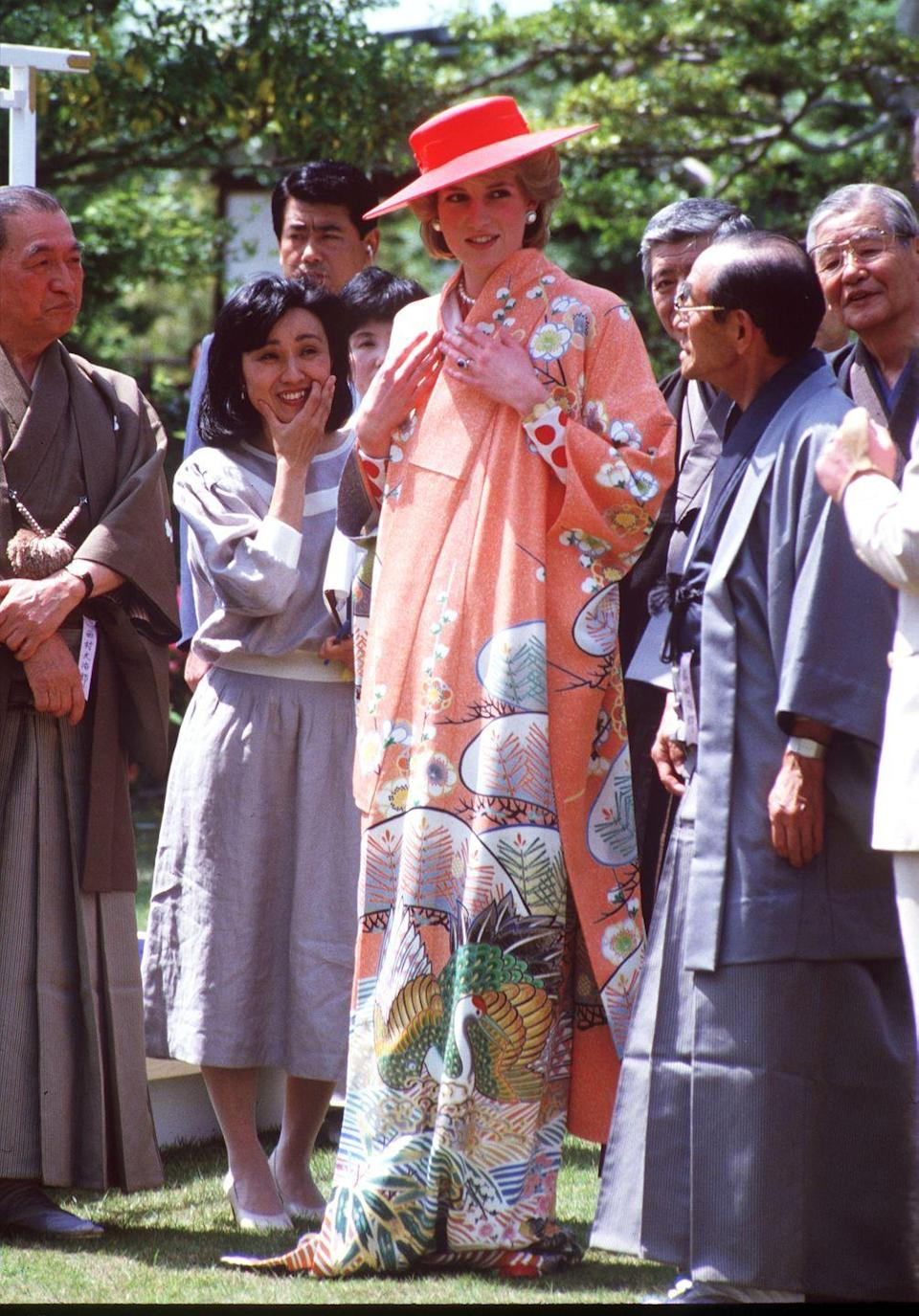 <p>In a peach kimono and matching hat during the Royal Tour of Japan. </p>