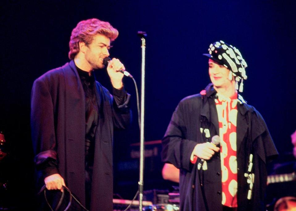 <p>George Michael and Boy George perform onstage at an AIDS awareness concert in London in April 1987. (Photo: Michael Putland/Getty Images) </p>