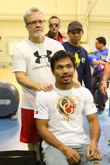 Freddie Roach poses for a photo with Manny Pacquiao before a training session. (Getty)