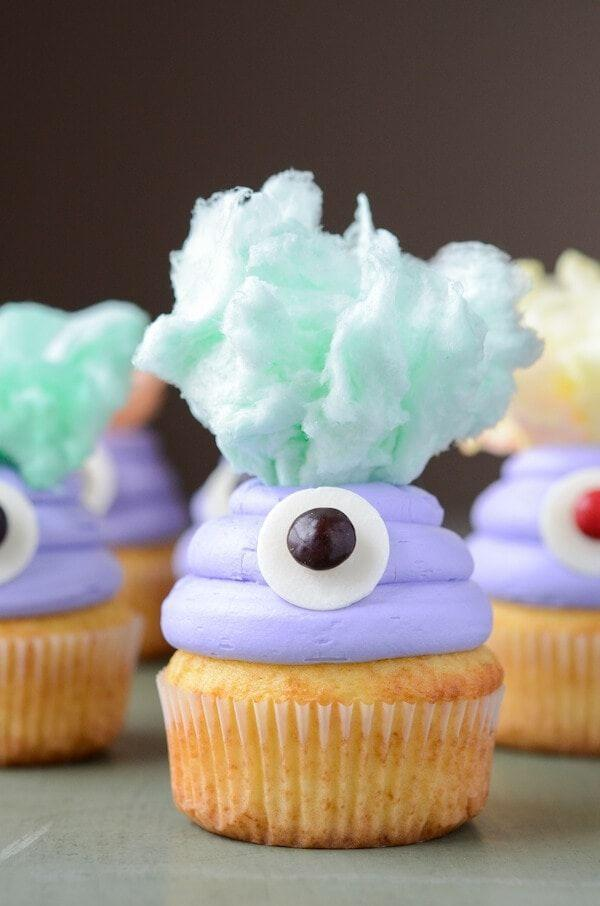 """<p>Little ones will love getting in on the fun decorating these one-eyed treats. They'll definitely like the cotton candy """"hair.""""</p><p><strong>Get the recipe at <a href=""""https://thenovicechefblog.com/monster-cupcakes/"""" rel=""""nofollow noopener"""" target=""""_blank"""" data-ylk=""""slk:The Novice Chef"""" class=""""link rapid-noclick-resp"""">The Novice Chef</a>.</strong></p><p><strong><a class=""""link rapid-noclick-resp"""" href=""""https://go.redirectingat.com?id=74968X1596630&url=https%3A%2F%2Fwww.walmart.com%2Fip%2FWilton-Icing-Color-Violet-1oz%2F24107655&sref=https%3A%2F%2Fwww.countryliving.com%2Ffood-drinks%2Fg1366%2Fhalloween-cupcake-ideas%2F"""" rel=""""nofollow noopener"""" target=""""_blank"""" data-ylk=""""slk:SHOP ICING GEL"""">SHOP ICING GEL</a><br></strong></p>"""