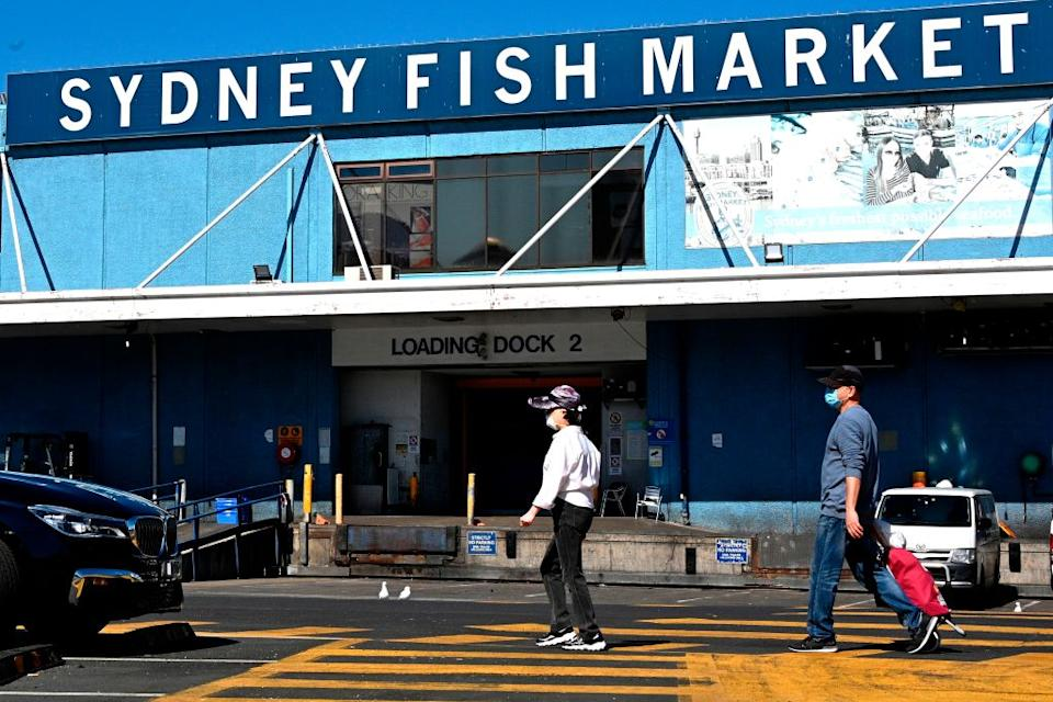 People are seen outside the Sydney Fish Markets.