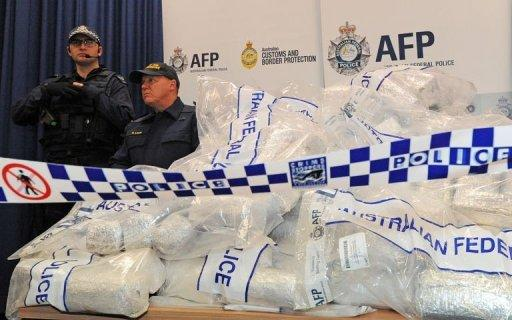 Police arrested seven people after finding 306 kilograms of 'ice' and 252 kilograms of heroin, worth US$525 million