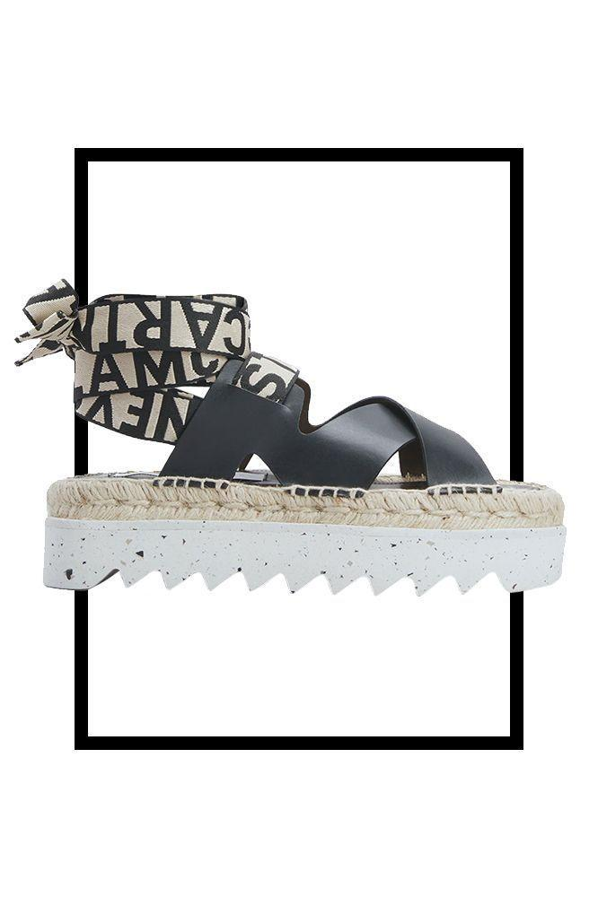 """<p><strong>Stella McCartney</strong></p><p>bergdorfgoodman.com</p><p><strong>$450.00</strong></p><p><a href=""""https://go.redirectingat.com?id=74968X1596630&url=https%3A%2F%2Fwww.bergdorfgoodman.com%2Fp%2Fstella-mccartney-gaia-ankle-wrap-espadrille-sandals-prod163780150&sref=https%3A%2F%2Fwww.marieclaire.com%2Ffashion%2Fg35798408%2Fbest-flatforms%2F"""" rel=""""nofollow noopener"""" target=""""_blank"""" data-ylk=""""slk:SHOP IT"""" class=""""link rapid-noclick-resp"""">SHOP IT</a></p><p>Opt for this ankle-wrap logo style if you're looking to make a statement.</p>"""