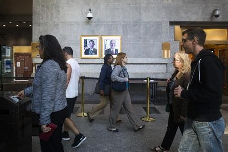 Federal workers enter the Ted Weiss Federal Building in the lower Manhattan area of New York