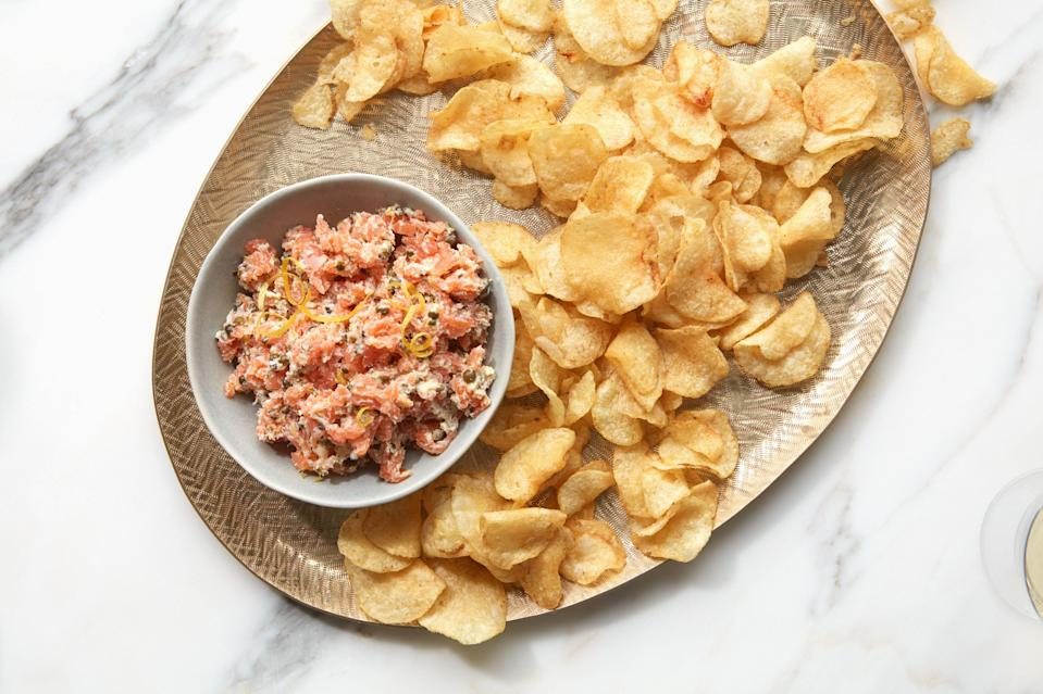 """If you love beef tartare but don't love the idea of leaving a bowl of raw beef out at a picnic, this recipe is for you. <a href=""""https://www.epicurious.com/recipes/food/views/smoked-salmon-tartare?mbid=synd_yahoo_rss"""" rel=""""nofollow noopener"""" target=""""_blank"""" data-ylk=""""slk:See recipe."""" class=""""link rapid-noclick-resp"""">See recipe.</a>"""