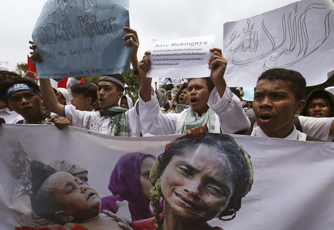 <p>Indonesia Muslim hold poster during a rally outside the Myanmar's Embassy in Jakarta, Indonesia, Wednesday, Sept. 6, 2017. (Photo: Achmad Ibrahim/AP) </p>