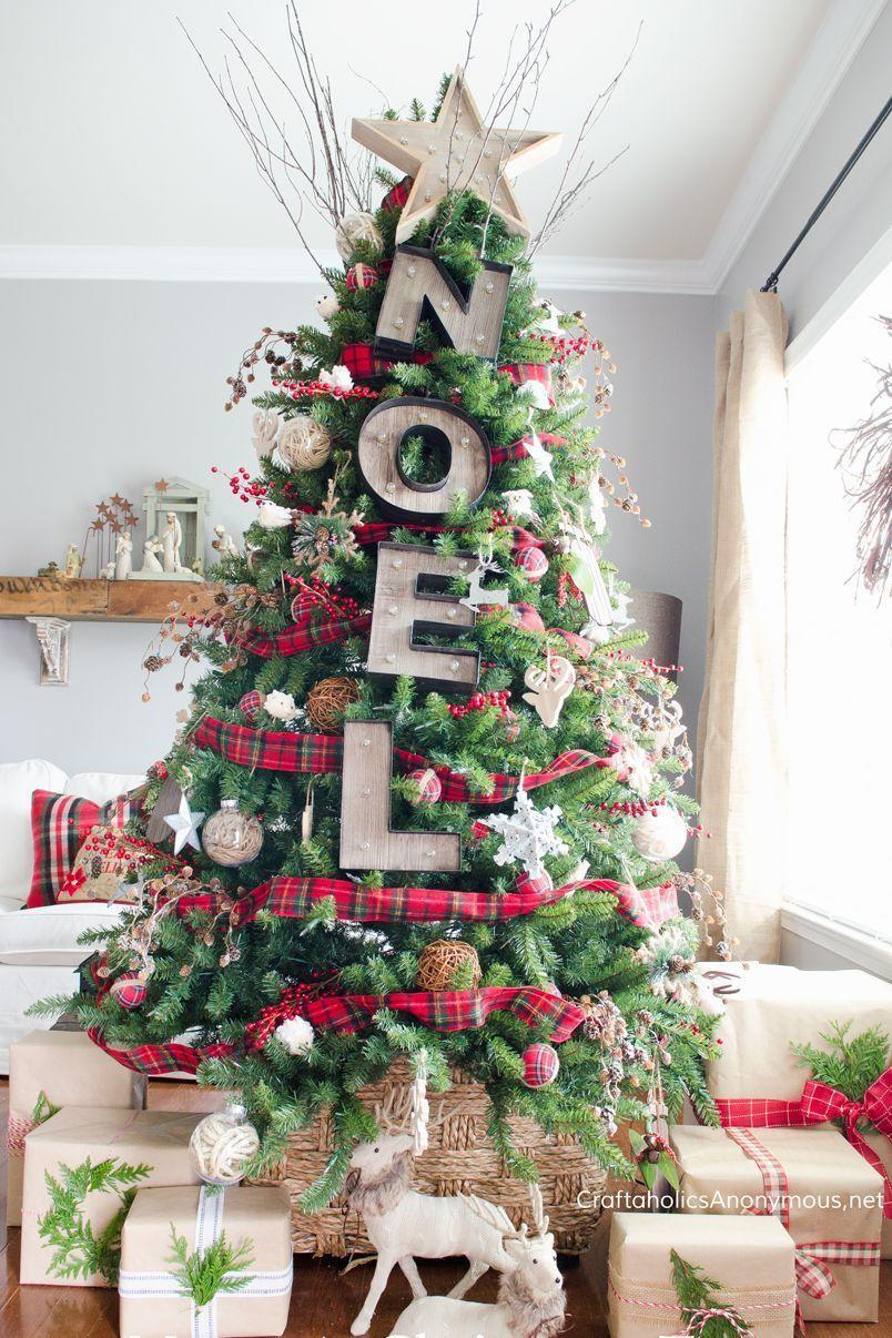 """<p>Write out a short phrase that sums up the holiday season — noel, joy, love, faith, and more — for a statement-making decoration. </p><p><a class=""""link rapid-noclick-resp"""" href=""""https://www.amazon.com/Darice-Silver-Metal-Marquee-Letter/dp/B0100IIB3E/r?tag=syn-yahoo-20&ascsubtag=%5Bartid%7C10055.g.2707%5Bsrc%7Cyahoo-us"""" rel=""""nofollow noopener"""" target=""""_blank"""" data-ylk=""""slk:SHOP MARQUEE LETTERS"""">SHOP MARQUEE LETTERS</a></p><p><em><a href=""""https://www.craftaholicsanonymous.net/rustic-marquee-christmas-tree"""" rel=""""nofollow noopener"""" target=""""_blank"""" data-ylk=""""slk:Get the tutorial at Craftaholics Anonymous »"""" class=""""link rapid-noclick-resp"""">Get the tutorial at Craftaholics Anonymous »</a></em></p>"""