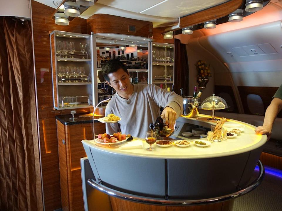 <p>From getting to skip the boarding line and enter the plane through a private entrance, to fancy suites featuring automatic doors, shower access, and a seemingly endless supply of food and drinks, this is what it's like (in Huang's own words) to take a trip of a lifetime. <i>(Photo: Sam Huang)</i><br></p>