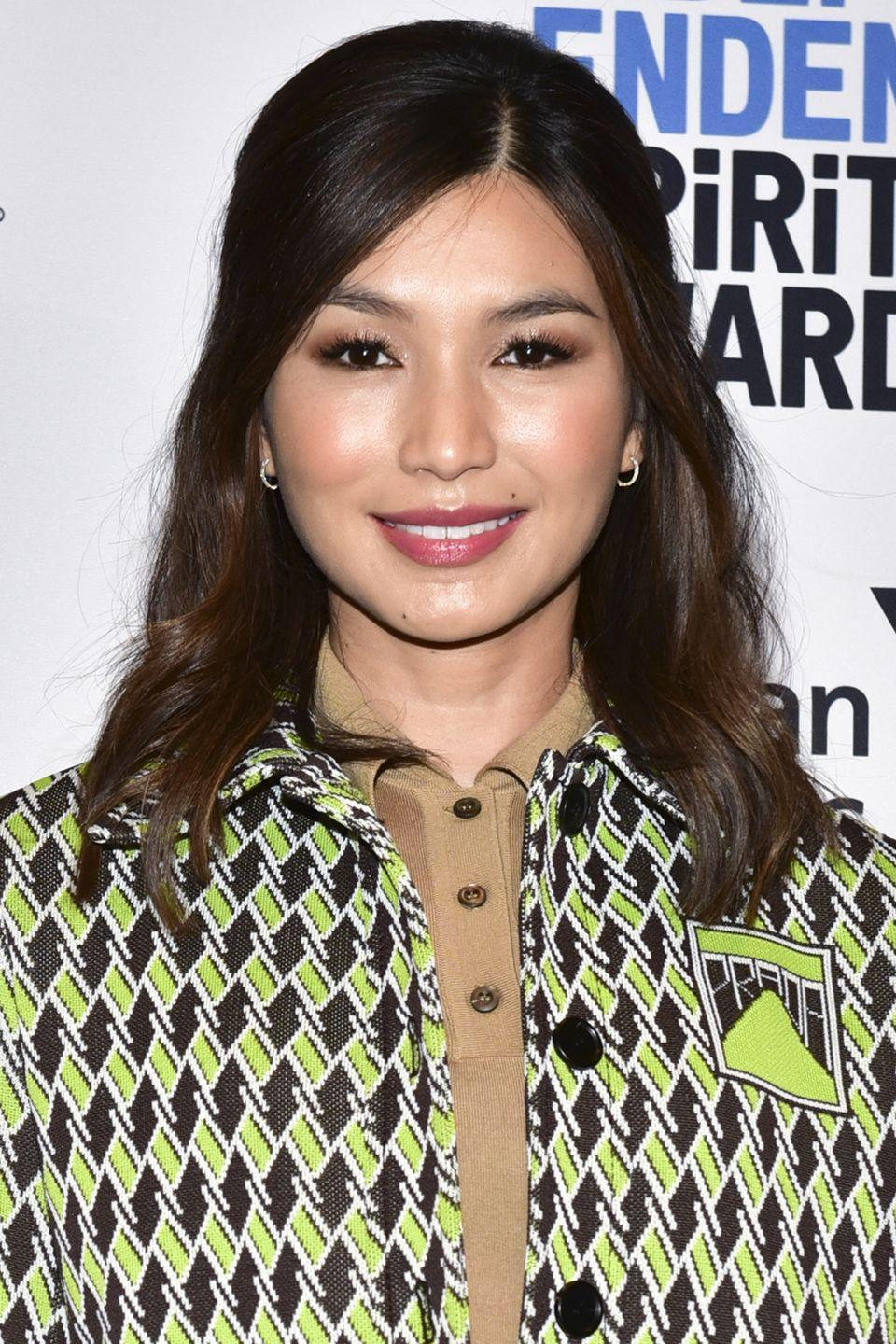 <p>For medium hair length, follow Gemma Chan's lead and part hair to the side before gathering some layers for a half-up, half-down style. Subtle waves give the style both volume and hold.</p>