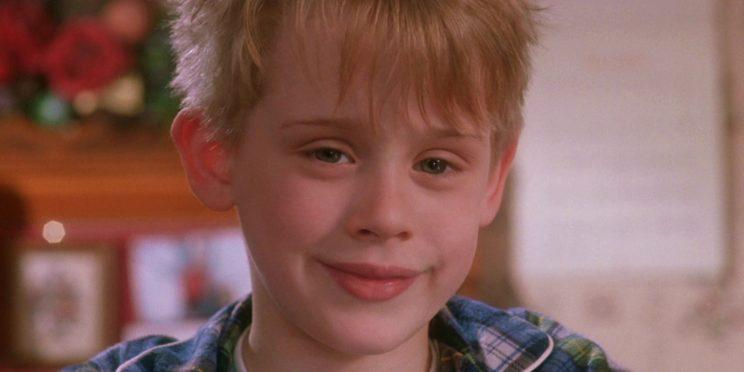 Macaulay Culkin smiling in Home Alone. Maybe because he knows Elvis is in it [Image via 20th Century Fox]