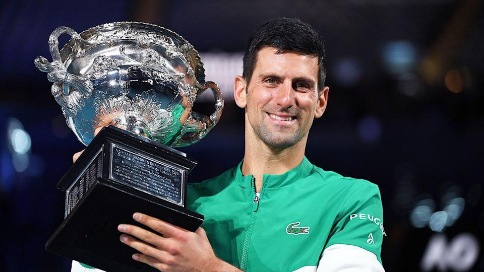Pictured here, Novak Djokovic poses with the 2021 Australian Open trophy.