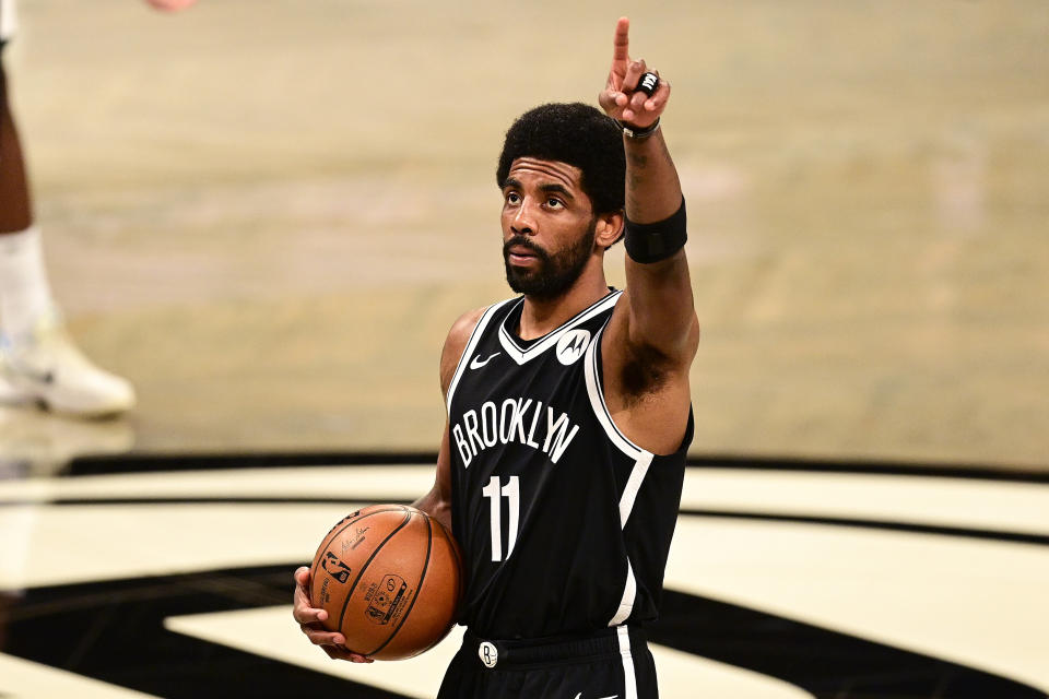 Brooklyn Nets star Kyrie Irving faces stiff financial penalties if he does not get vaccinated prior to the start of the NBA's regular season. (Steven Ryan/Getty Images)