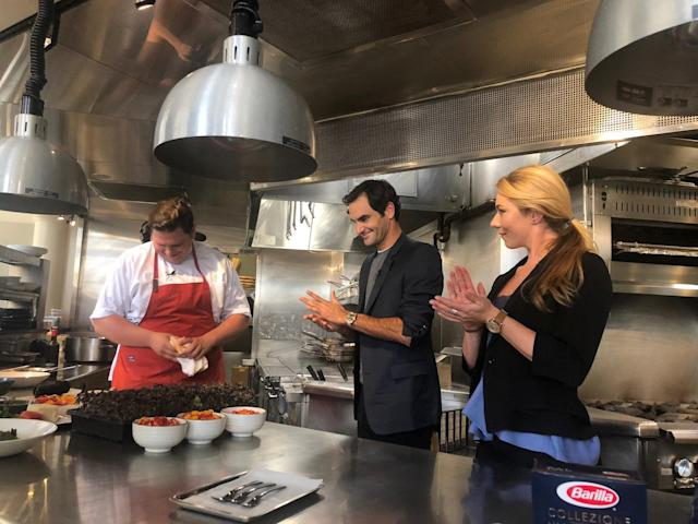 U.S. Alpine skier Mikaela Shiffrin (R) with Swiss tennis star Roger Federer and Joe Flamm during a cooking demonstration by sponsor, Barilla, in Chicago, Illinois, U.S., September 18, 2018. Photo taken September 18, 2018. Megan Harrod/U.S. Ski & Snowboard/Handout via REUTERS ATTENTION EDITORS - THIS IMAGE WAS PROVIDED BY A THIRD PARTY. NO RESALES, NO ARCHIVE