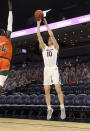 Virginia forward Sam Hauser (10) shoots over Miami guard Elijah Olaniyi (4) during an NCAA college basketball game Monday in Charlottesville, Va. (Andrew Shurtleff/The Daily Progress via AP, Pool)