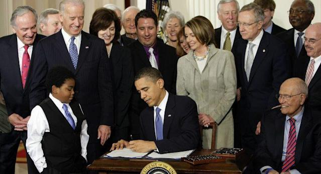 President Barack Obama signs his health care bill in the East Room of the White House, March 23, 2010. (Photo: J. Scott Applewhite/AP)