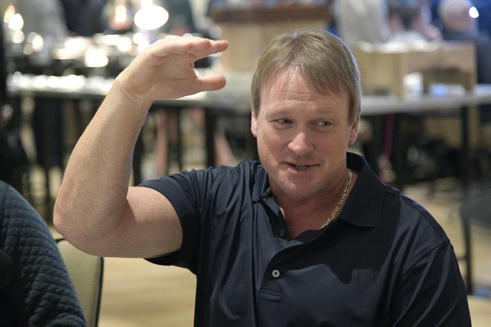 Oakland Raiders head football coach Jon Gruden answers a question from a reporter at the coaches breakfast during the NFL owners meetings, Tuesday, March 27, 2018 in Orlando, Fla. (PAP Images for NFL)