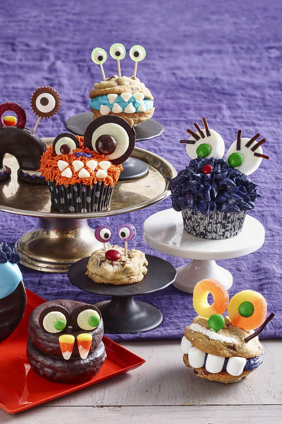 """<p>Make an assortment of multi-colored cupcake monsters, complete with licorice lashes and candy teeth, for your friends to snack on this Halloween.</p><p><em><a href=""""https://www.womansday.com/food-recipes/food-drinks/a28860615/one-eyed-monster-cupcake-recipe/"""" rel=""""nofollow noopener"""" target=""""_blank"""" data-ylk=""""slk:Get the Monster Cupcakes recipe."""" class=""""link rapid-noclick-resp"""">Get the Monster Cupcakes recipe.</a></em></p>"""