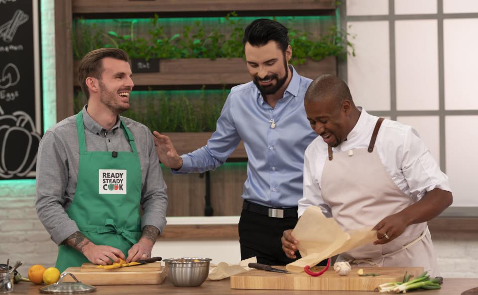 Rylan Clark-Neal is fronting the cookery show's revival with help from new chefs. (BBC/Endemol/Graeme Hunter)