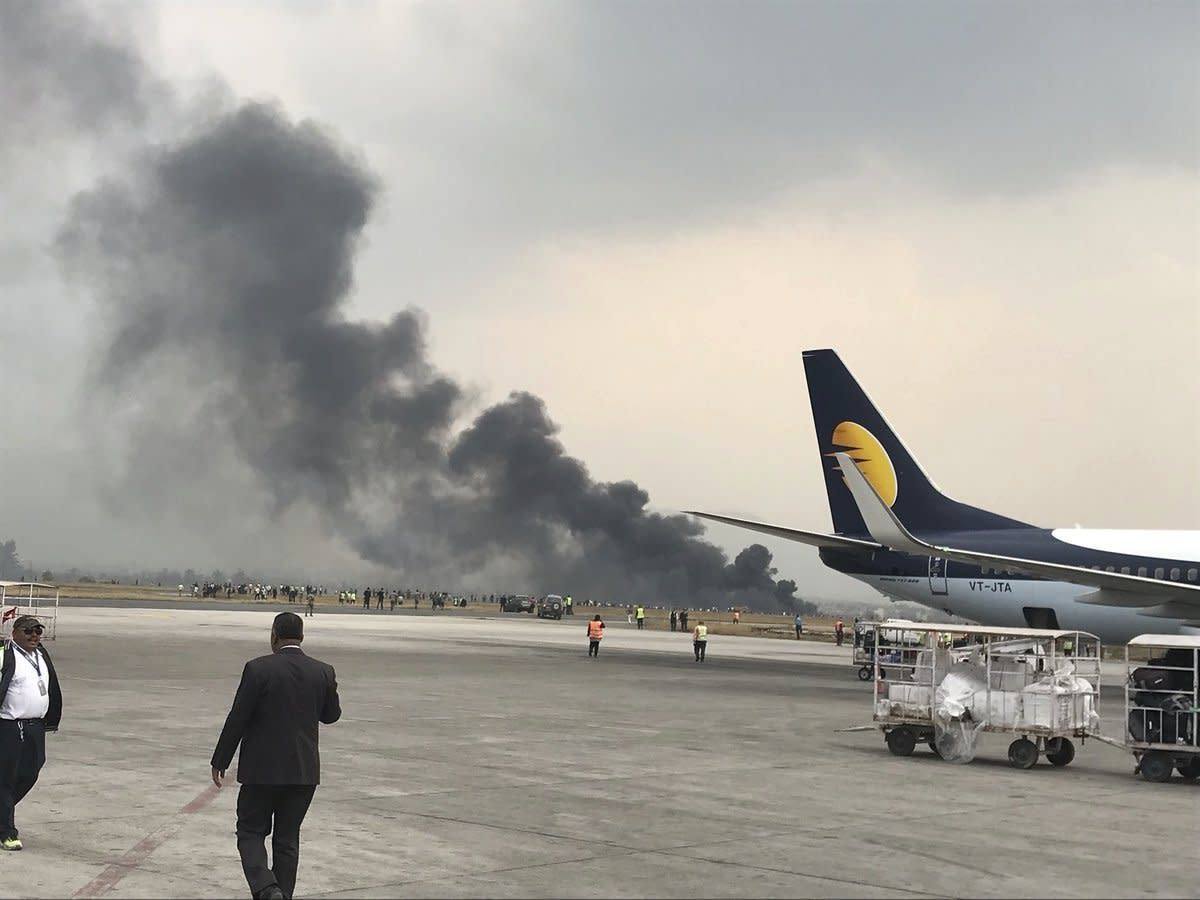 <p>Smoke rises after a passenger plane from Bangladesh crashed at the airport in Kathmandu, Nepal, March 12, 2018. (Photo: Bishnu Sapkota via AP) </p>