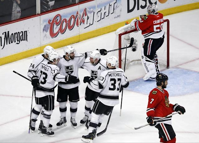 Los Angeles Kings center Tyler Toffoli (73) celebrates his goal with his teammates during the second period in Game 7 of the Western Conference finals against the Chicago Blackhawks in the NHL hockey Stanley Cup playoffs Sunday, June 1, 2014, in Chicago. (AP Photo/Charles Rex Arbogast)