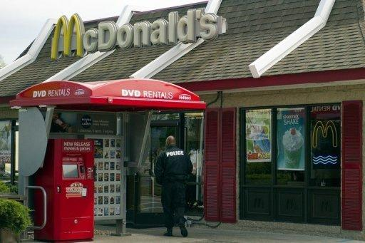 "A policeman stands watch outside a McDonald's outlet in Baltimore on April 5. Mirlande Wilson - an assistant manager at the restaurant who had claimed at the start of the week that she held a winning Mega Millions ticket - told a Washington television station that she had ""misplaced"" it"