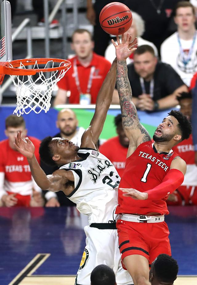 Brandone Francis #1 of the Texas Tech Red Raiders shoots against Xavier Tillman #23 of the Michigan State Spartans during the second half of the semifinal game in the NCAA Men's Final Four at U.S. Bank Stadium on April 06, 2019 in Minneapolis, Minnesota. (Photo by Matt Marriott/NCAA Photos via Getty Images)
