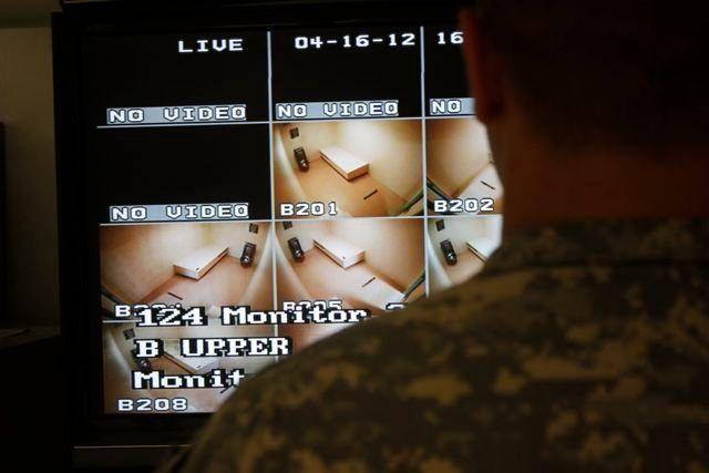 A Guantanamo guard looks over a video screen at Camp VI at Guantanamo in April. Detainees had blocked 147 of the prison's 160 cameras, according to a military official.