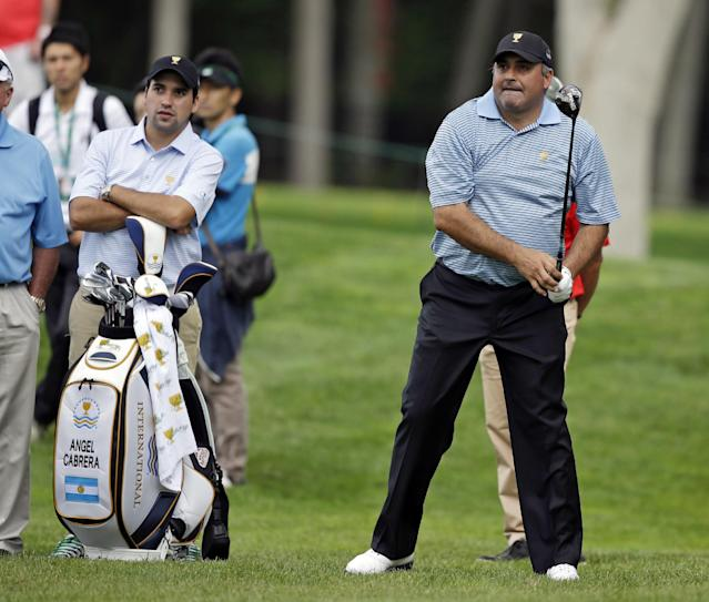 International team player Angel Cabrera, of Argentina, watches his second shot on the seventh hole during a practice round for the Presidents Cup golf tournament at Muirfield Village Golf Club Tuesday, Oct. 1, 2013, in Dublin, Ohio. (AP Photo/Darron Cummings)