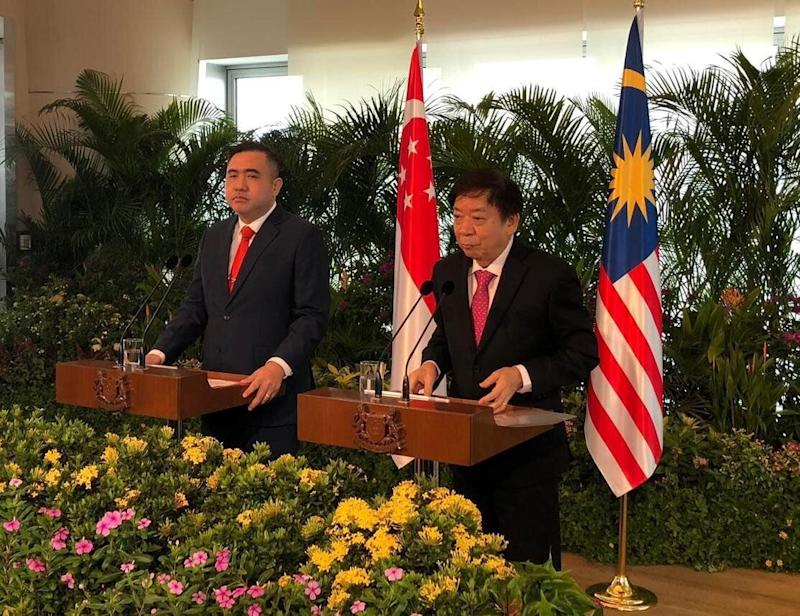 Singapore Transport Minister Khaw Boon Wan and his Malaysian counterpart Anthony Loke at a news conference in Singapore on 21 May 2019. PHOTO: Nicholas Yong/Yahoo News Singapore