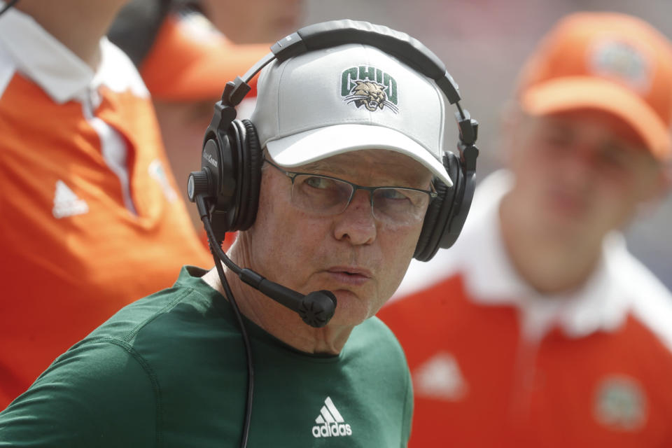 """FILE - Ohio head coach Frank Solich watches along the sideline as his team plays against Pittsburgh during the second half of an NCAA college football game in Pittsburgh, in this Saturday, Sept. 7, 2019, file photo. Ohio coach Frank Solich is retiring after leading the program through 16 seasons of unprecedented success to """"focus on his health,"""" the school said Wednesday, July 14, 2021. The school announced that Solich was stepping down less than two months before the start of the season and his 77th birthday. Offensive coordinator Tim Albin was promoted to head coach. (AP Photo/Keith Srakocic)"""