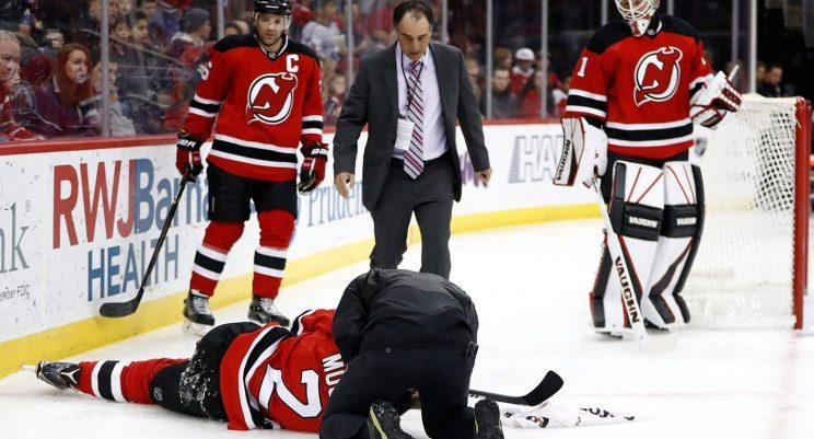 John Moore lays on the ice after being hit from behind by Tom Wilson. (Julio Cortez/AP)