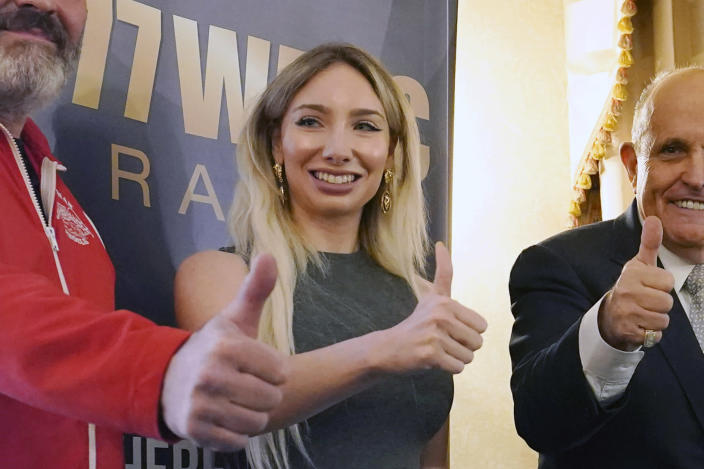 "FILE - In this Wednesday, Sept. 16, 2020, file photo, Manhattan GOP chairwoman Andrea Catsimatidis poses for a photograph during a news conference at the Women's Republican Club in New York. ""Corporate America helped rig the election,"" she retweeted after President Joe Biden's inauguration. (AP Photo/Kathy Willens, File)"